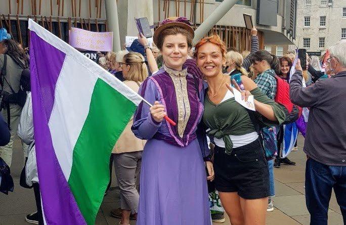 Anti-trans protesters who booed Nicola Sturgeon pose in suffragette colours
