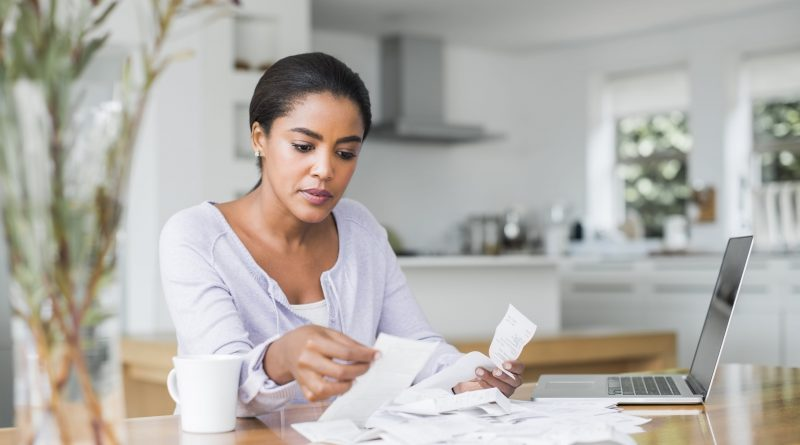 Here's how much of your monthly income should go toward debt repayment