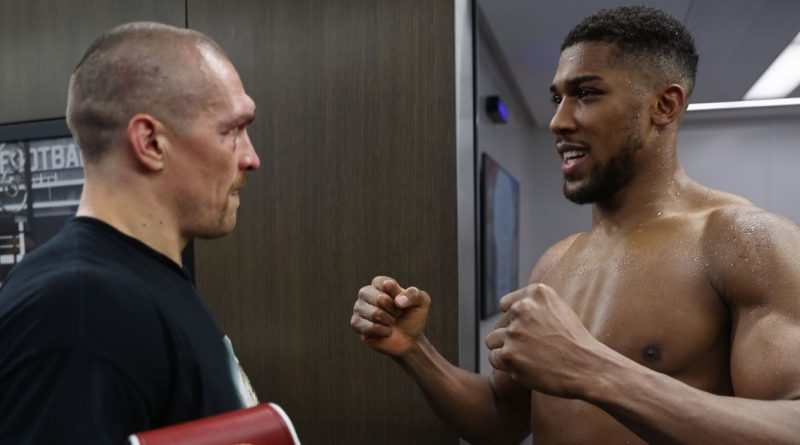 Oleksandr Usyk gives belts back to Anthony Joshua during backstage meeting