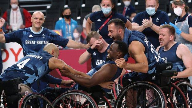Great Britain's men's wheelchair basketball players celebrate winning the Tokyo Paralympics bronze medal against Spain