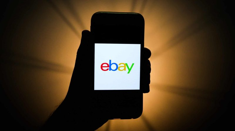 A mobile phone showing the eBay logo