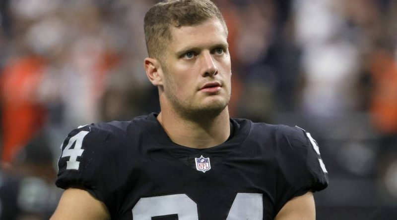 Carl Nassib exits the field after the Las Vegas Raiders lost to the Chicago Bears