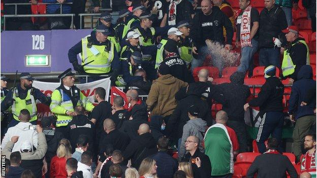 Fans clashed with stewards and police early in the game