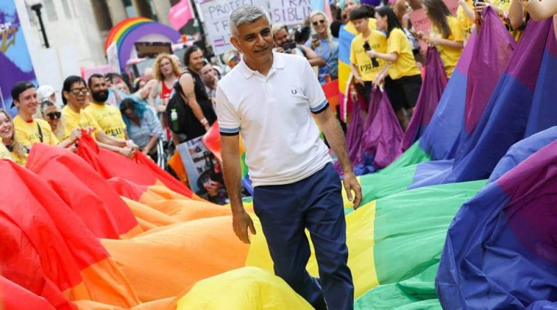 London mayor Sadiq Khan steps on top of a long LGBT+ pride flag during Pride in London 2019 celebration